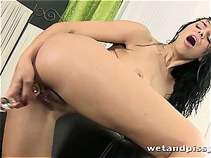 huge-titted Elena Rae urinates thru her stockings