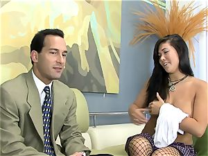 London drilled on a sofa in fishnet stockings