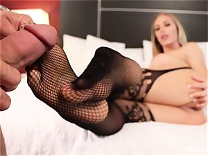 gorgeous Nicole Aniston gives her man a footjob