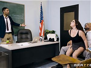 teacher Angela white filled plums deep in her classroom