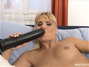 Czech light-haired Barra Brass gets gaped by a brutal fake penis