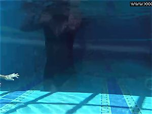 Tiffany Tatum strips naked underwater